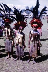 073 3 Chimbu children wearing black cassowary feathers and cuscus fur
