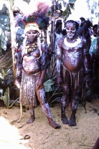074 Goroka man and girl with pythons. She has betel nut around her neck