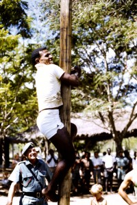 Battalion Sports Day Herman Komeng up the pole with I think RSM McKay looking on.