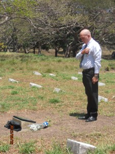 Glenn Maitland (RSL Sub Branch President) dedicating RSM Wilson's grave
