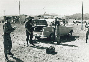 Photo taken at RAAF Base, Port Moresby L-R Phil Parker, Maurice Jenner and Bruce Boxall from 1PIR with Car bilong yumi