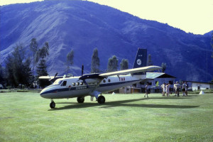 Dan's Tours lands at Tapini. Twin Otter that was restricted to 19 passengers from memory because of the nature of this airstrip. A typical airstrip on the side of a montain requiring a last minute 90 degree turn before landing.