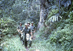 Group of us on the Kakoda Track. Sgt Nei Gibson in front, Sgt Don Benson on the right, Sgt Frank Cordingley on the left, and Sgt Ken Morcom in the centre.