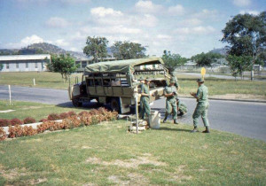 Outside Murray Barracks Ed Section - John Rae next to bin. Loading the truck with provisions